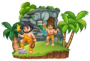 Due uomini delle caverne nella casa rocciosa