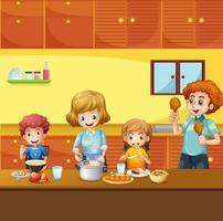 Familj med måltid i köket