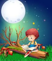 Menino lendo livro no jardim à noite