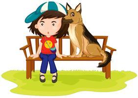 Tjej och hund sitter i parken
