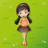Gelukkig meisje dat op gras ligt