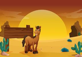 Segno di legno nella terra del deserto occidentale