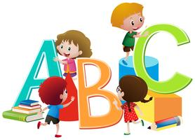 Children with English alphabets blocks
