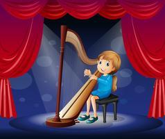 Liten tjej som spelar harpa på scenen