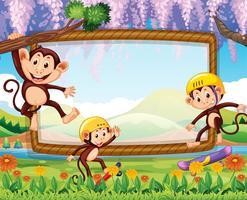 Design de fronteira com três macacos no parque