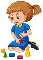 Little girl playing shape blocks