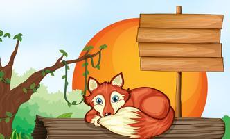 Sinal de madeira e raposa no log