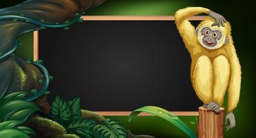 Grensmalplaatje met gibbon in het hout