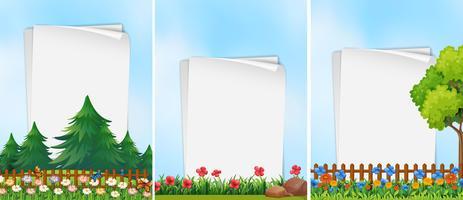 Tres plantillas de papel con fondo de jardín