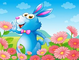 En kanin med blommor i trädgården