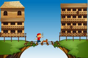 Boy crossing bridge on the cliff