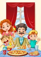 Familj som har pizza på matbordet