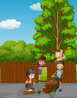 Niños arreglando la cerca en el jardín.