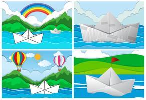 Vier scènes met papieren boten op zee