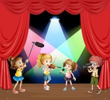 Kids performaning music on stage