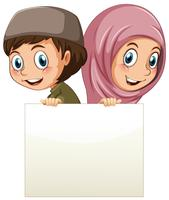 Muslim girl and boy holding blank paper