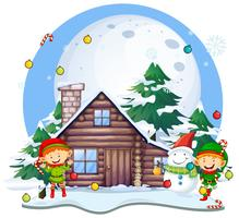 Christmas eleves and snowman by cottage