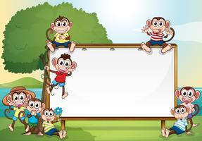 Design de moldura com macacos no parque
