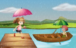 Niña y niño bajo la lluvia en el parque