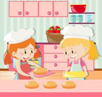 Dos chicas haciendo pastel en la cocina