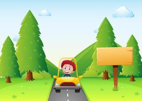 Boy driving yellow car on the road