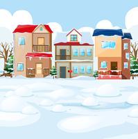 Scène de village avec de la neige sur les maisons