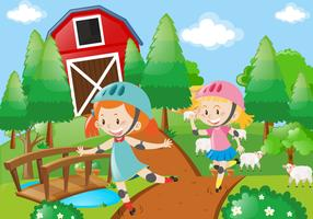 Two girl rollerskate in the farmyard