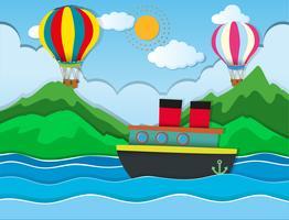 Barco navegando en el mar y globos volando en el cielo.