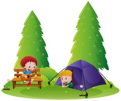 Two boys camping out in the park