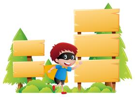 Wooden sign template with boy in hero clothes