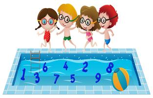 Children in swimming suit playing with numbers in the pool