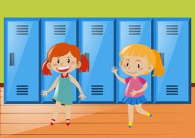 Two girls in front of lockers