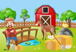 Agricultor e animais no campo de fazenda