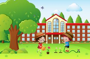 Boy and girl watering plants at school