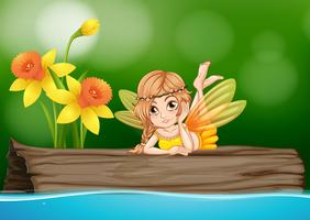 Cute fairy sitting on wooden log