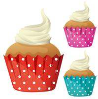 Cupcake with cream in different color cups