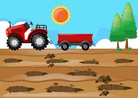 Escena de la granja con tractor en el campo.