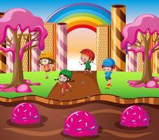 Gelukkige kinderen die in suikergoedland spelen