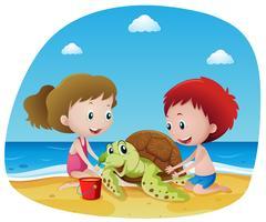 Barn och havssköldpadda på stranden