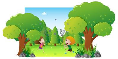 Park scene with two kids catching butterfly