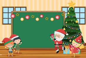 Blackboard in classroom with Santa and children