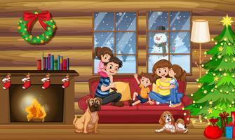 Una familia feliz en la casa en navidad