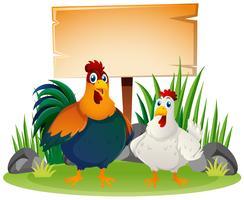 Letrero de madera y dos gallinas.