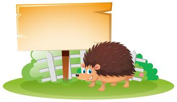 Wooden board and hedgehog in garden