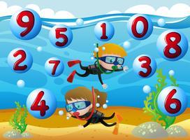 Crianças mergulho com números no mar