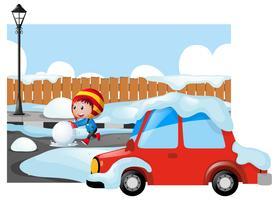 Winterszene mit Kind auf schneebedeckter Straße