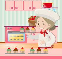 Mujer panadero hornear en la cocina