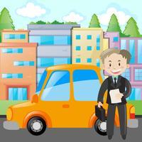 Affärsman står med gul bil