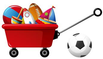 Red wagon with many toys and balls