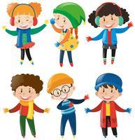 Happy children in winter clothes